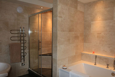 Bathroom with walk-in shower and separate bath